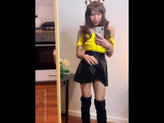 Cute ladyboy Sashimi Shush playing with her cock in her skirt.
